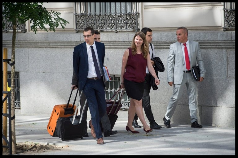 Lawyers for an accused Russian hacker, Pyotr Y. Levashov, leaving court after his extradition hearing in Madrid in July.  CreditLuca Piergiovanni/European Pressphoto Agency