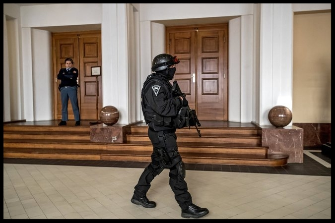 A prison officer outside a courtroom at the start of the trial of an accused Russian hacker, Yevgeny A. Nikulin, in Prague in November.