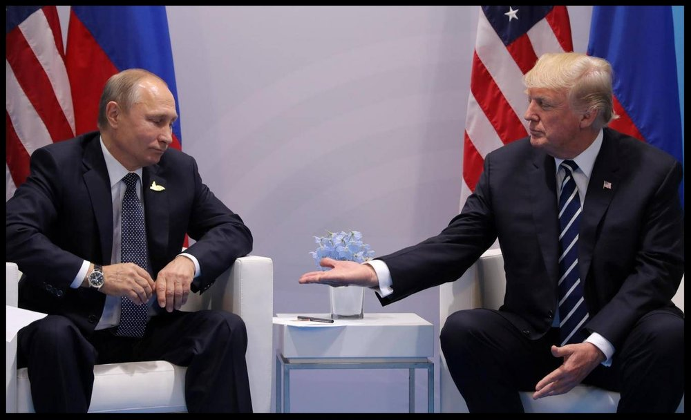 Russian leader Vladimir Putin (left) meeting US president Donald Trump Reuters