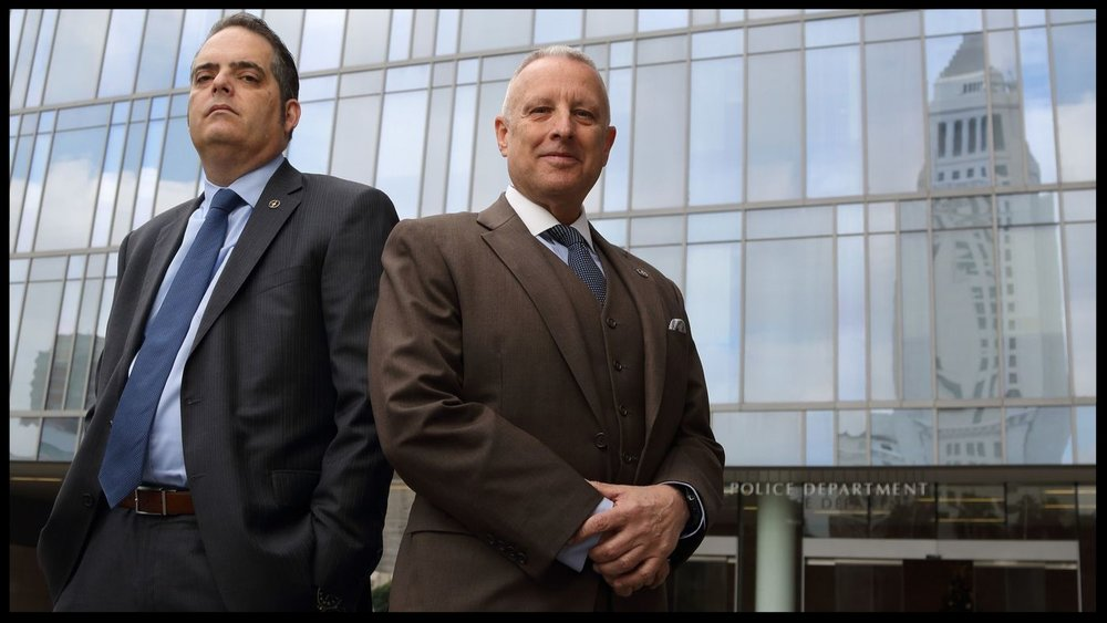 LAPD Det. Greg Stearns, left, and Lt. Walt Teague investigated a 2006 triple murder that happened in L.A. but was ultimately prosecuted last year in China.  (Myung J. Chun / Los Angeles Times)
