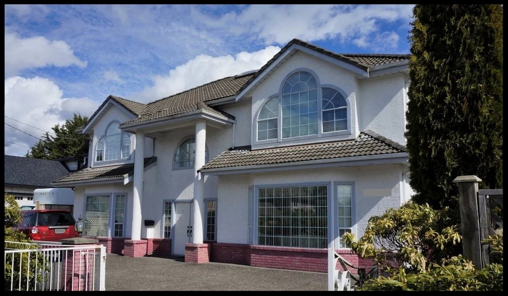 The home of the former unlicensed immigration consultant Xun 'Sunny' Wang, in Richmond, British Columbia. Since being freed from prison, Wang has returned to the $1.5 million home that was among locations raided by Canadian border officers on October 17, 2012.