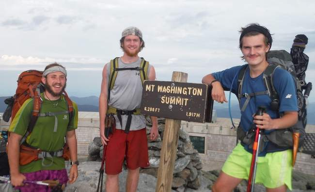 Sam Kooharian, Brett Depolo and Micahle Demanche at the Mount Washington Summit of the Appalachian Trail. Photo by Michael Demanche