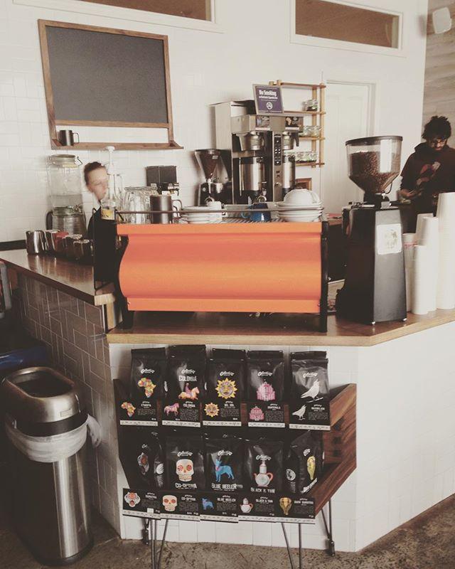 @burlycoffeebrooklyn chalkboard, tea leaf shelf, coffee bean display shelf.
