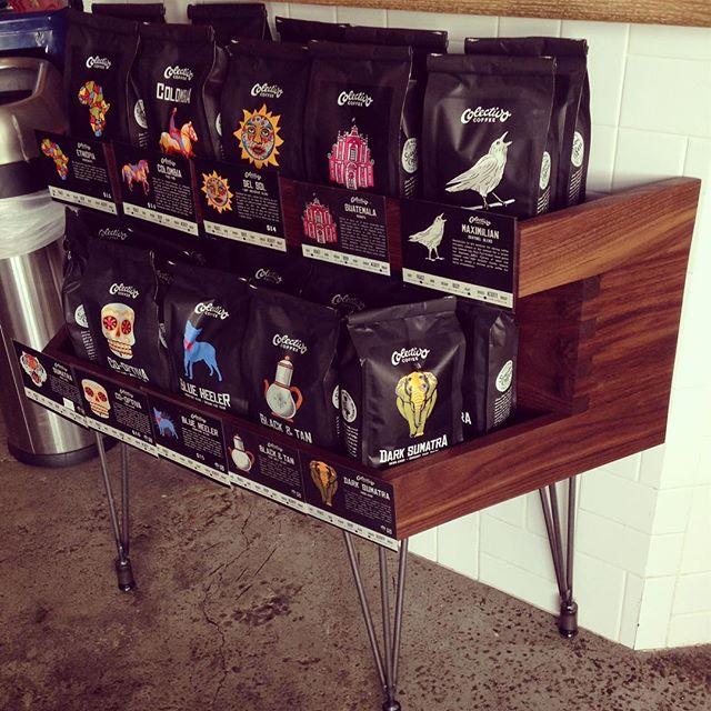 Walnut coffee display shelf with angled box joints.