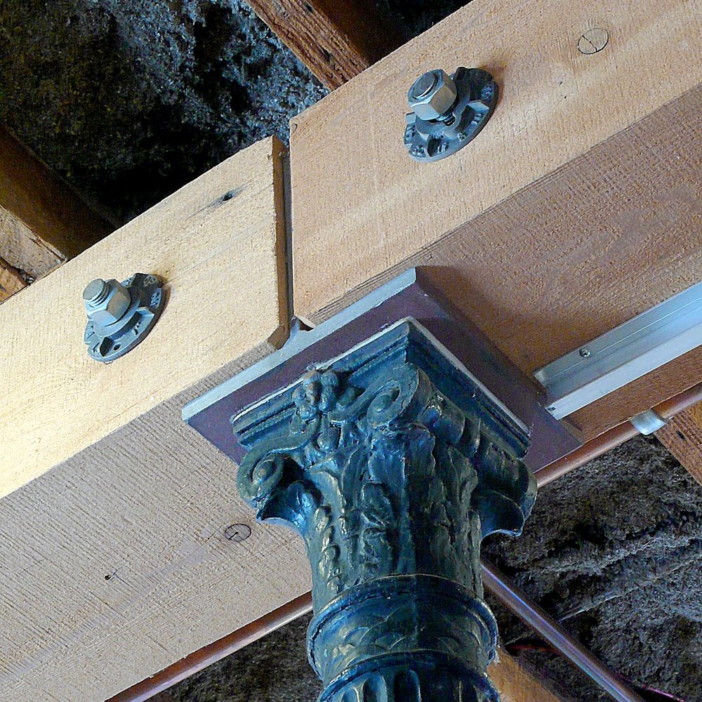 Detail of post and beam connection, cast-iron columns were reclaimed