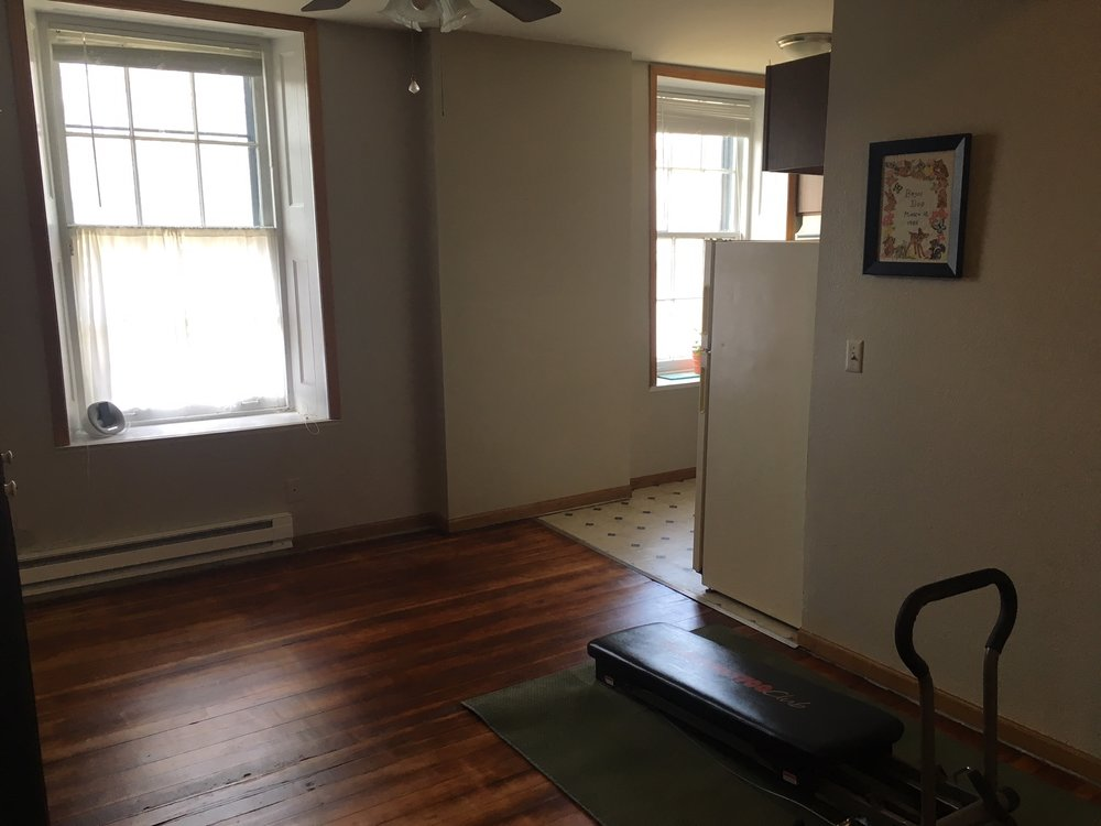 In addition to the bedroom bath and kitchen is a sitting room with hardwood floors.