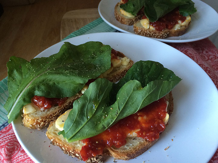 Tomato Jam with Soft Cheese and Arugula on Toast