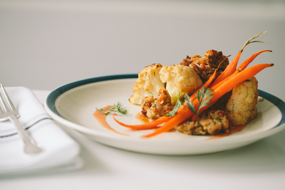 cauliflower roti. bread stuffing, carrots, vegetable demi-glace