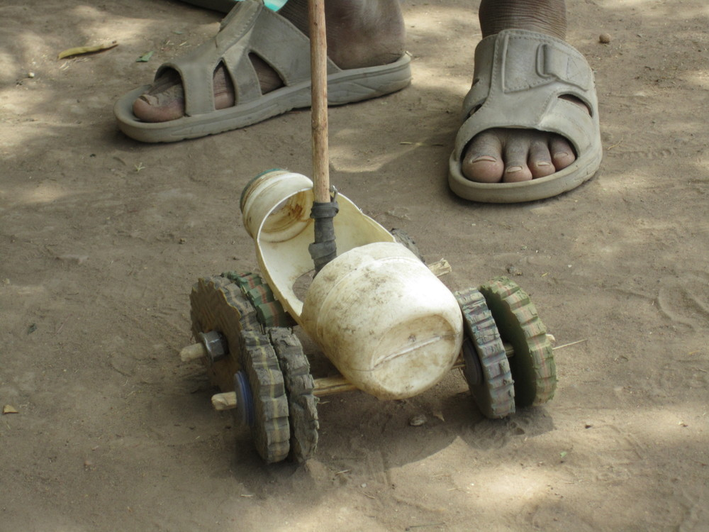 Toy made from milk bottle and flip-flops, Zina, Northern Cameroon