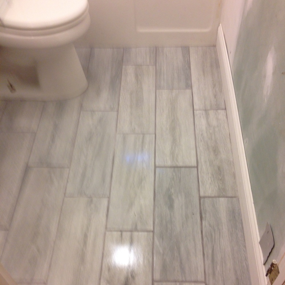 Bathrooms brandell remodeling services llc wood grain tile floor to compliment the hardwood floors that run throughout the home dailygadgetfo Gallery