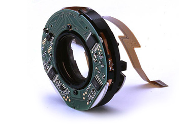 This is the IS unit that moves the floating lens element inside an image stabilised lens to keep the image steady on the surface of the sensor or film.