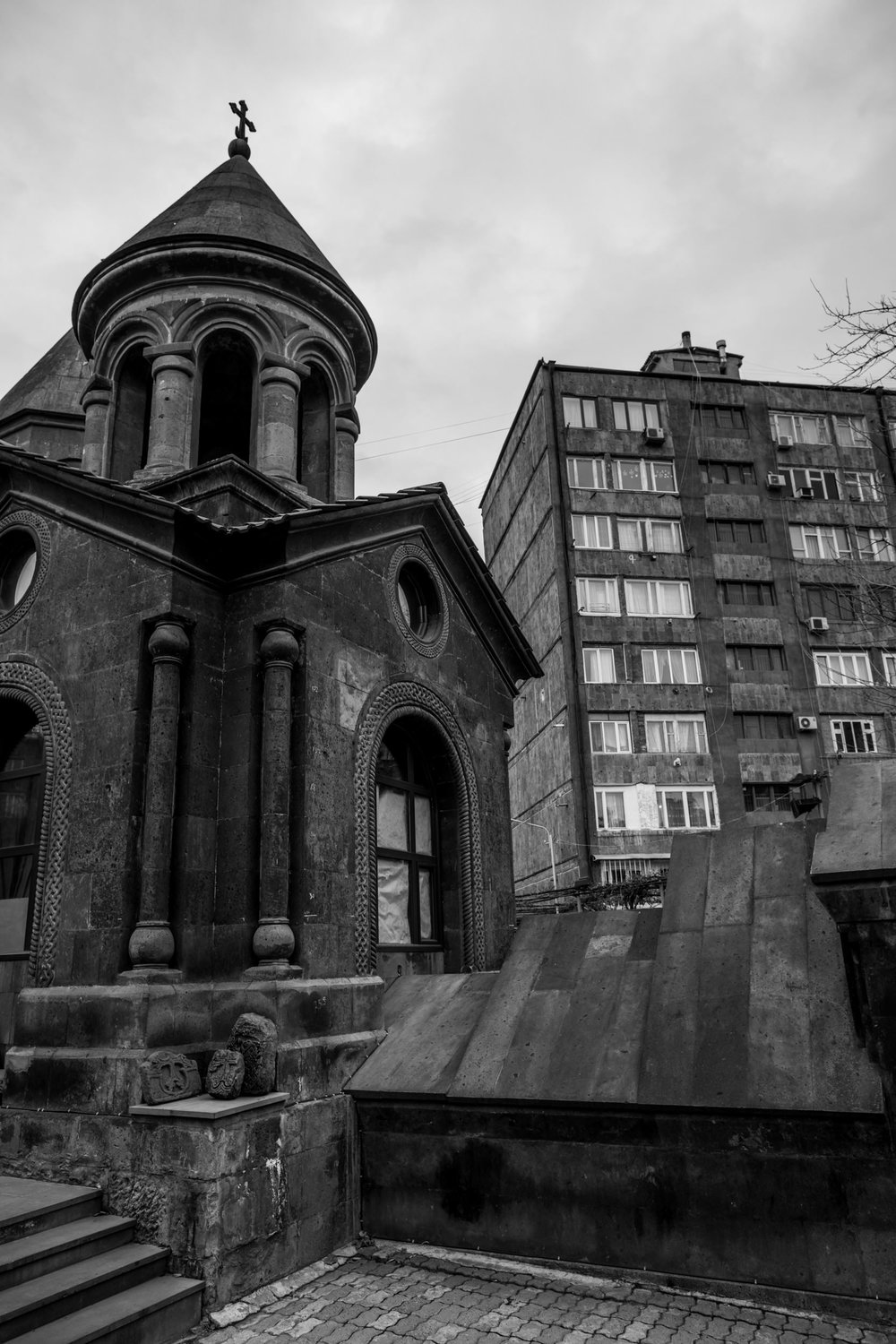 Zoravor S. Astvatsatsin Church sits hidden amongst its significantly younger and ugly concrete 'friends'