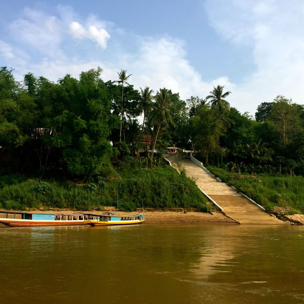 You've arrived!  Here is where your slow boat will pull up and let you off, to ascend the stairs to Luang Prabang. See where the dark stairs turn to light?  This is how high the river rises during the rainy season.