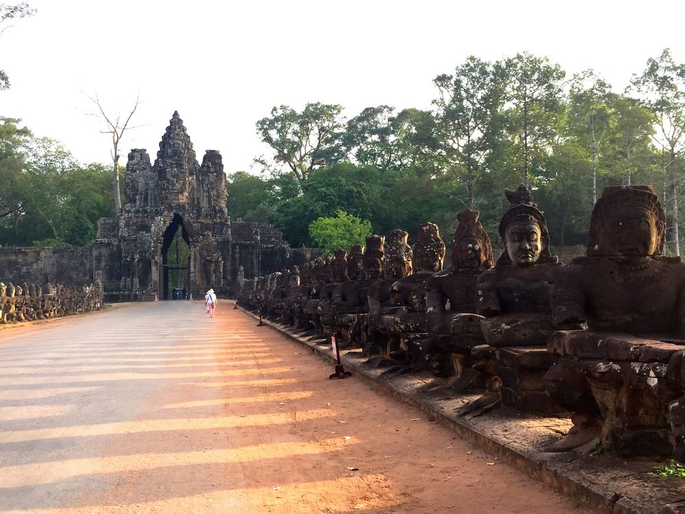 "One bridge leading to Angkor Wat still has it's ""faces.""  Some are original and some aren't but at least they are there and not beheaded.  The right side has demons and left, gods."