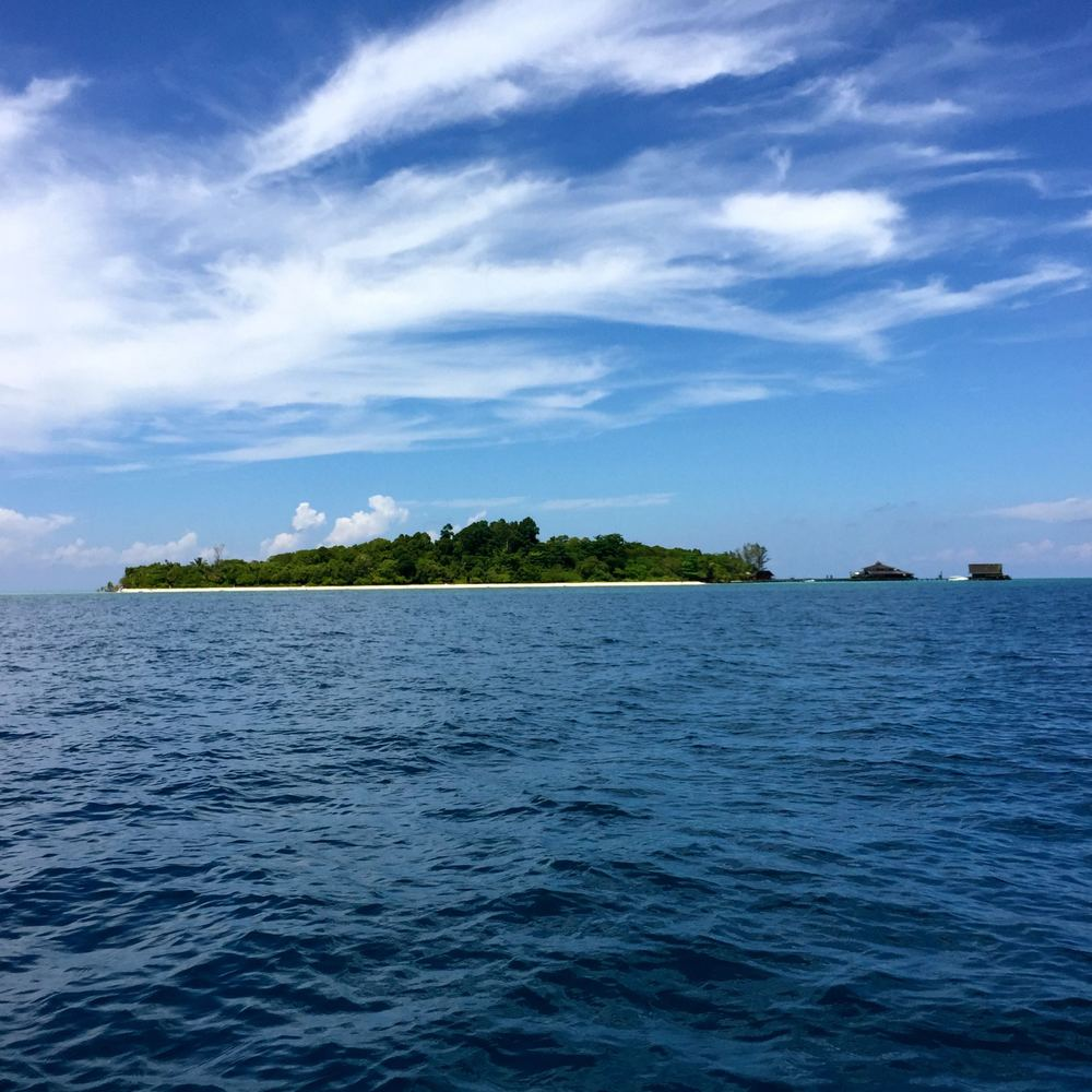 The view approaching Lankayan Island, with visuals of the dive shop and the pavilion where all meals were served.  These were the only two structures besides your cabin you could go to on the island.