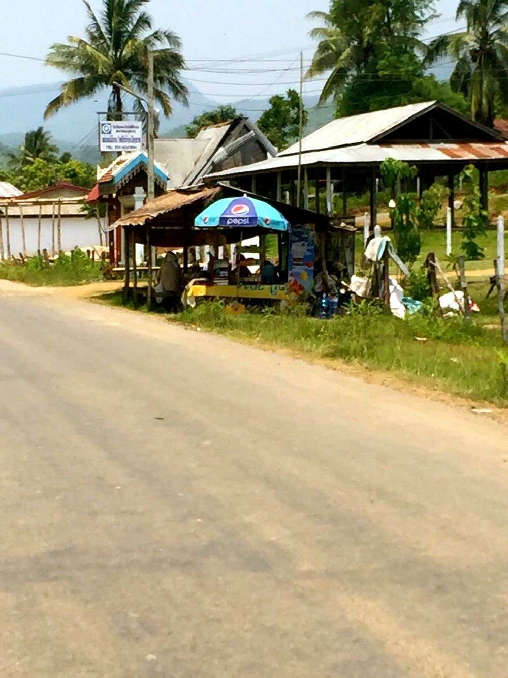 I rode a tuk tuk through the countryside of Laos.