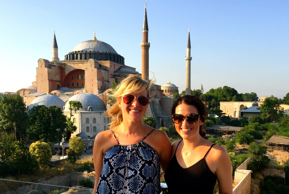 Windblown in front of the pretty in pink Hagia Sophia