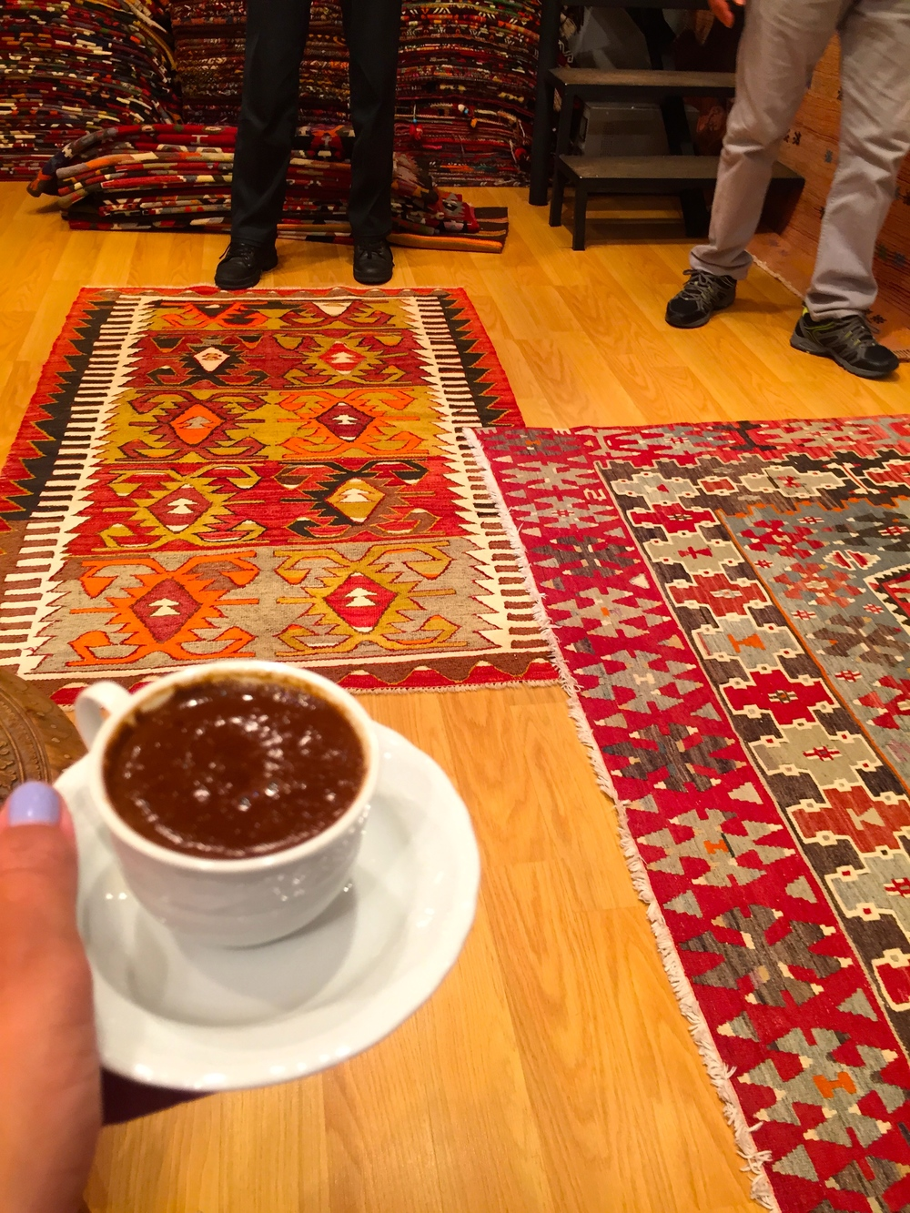 While discussing various kilim rugs, we sipped Turkish coffee then, when we got to the grounds we flipped the cup over and the shopkeeper read our fortunes from the groups.  They were... interesting.  Here's hoping they come true.
