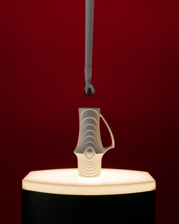 Rose Kallal    The Drop , 2016  Lighted pedestal, porcelain KPM Royal vase, wood, cast iron, class  Detailed view