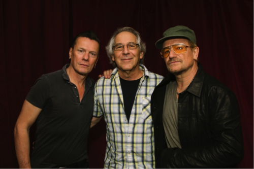 Norm with Larry Mullen, Jr. (left) and Bono (right).