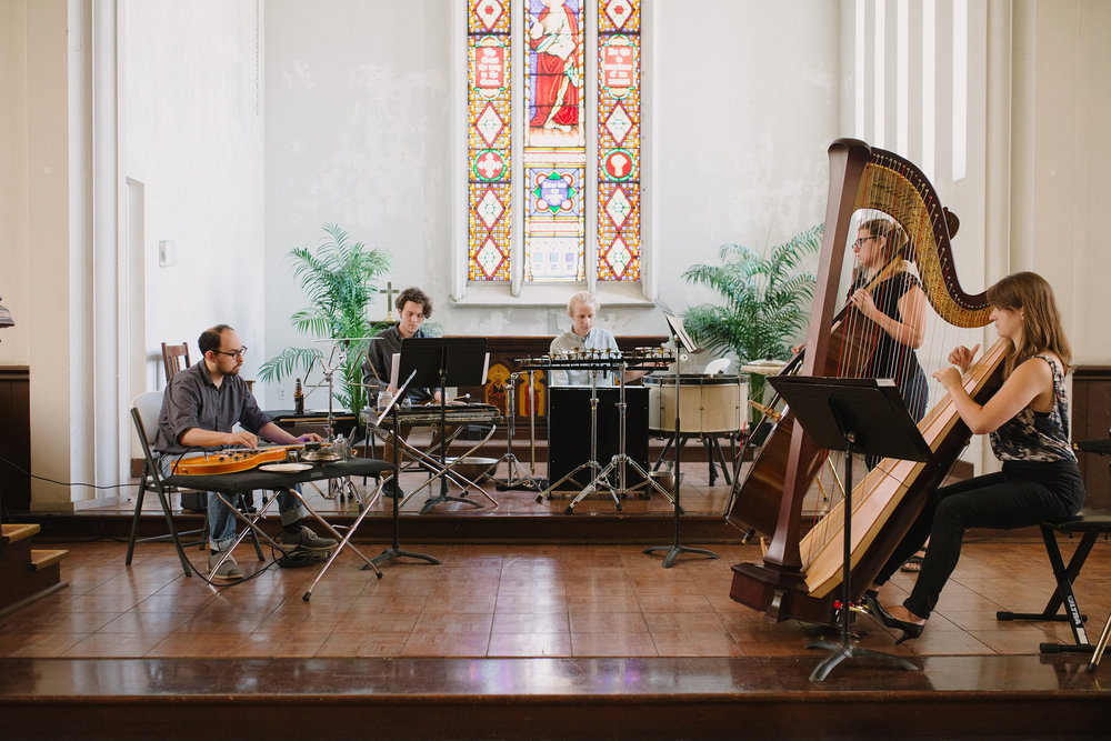 The Syndicate for the New Arts are Artists in Residence at St. John's. They offer concerts throughout the year and open rehearsals for visitors to witness and ask questions during the composing and practicing process.