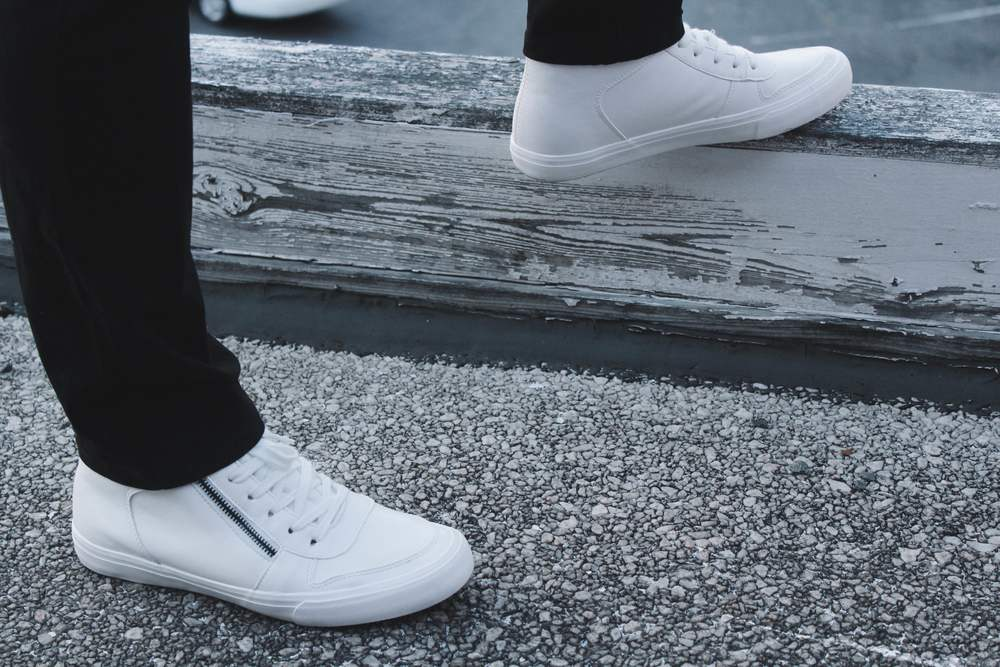 You can go with simple, white sneakers, a black pair, or even loud/bright trainers to make a statement.
