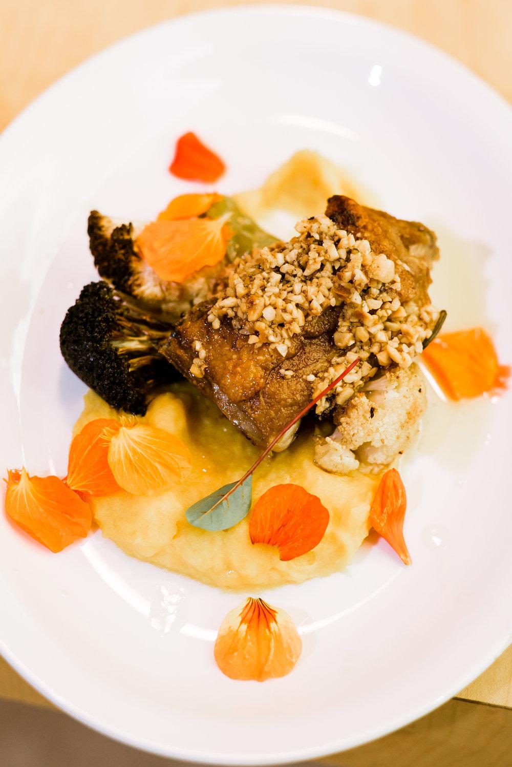 Oven Roasted Chicken  thigh butternut squash-potato mash, hard roasted cauliflower and broccoli, hazelnut brown butter sage