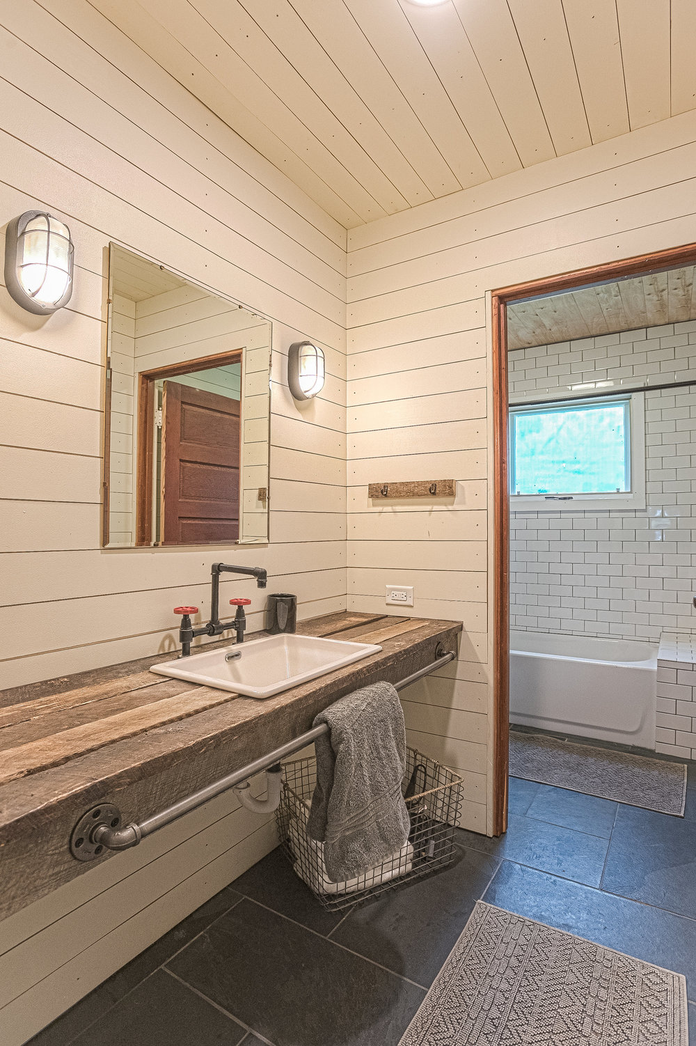 Main house guest bathroom with lots of character including steam punk faucet, reclaimed timber vanity and subway tile.  Brushing your teeth has never been so much fun!