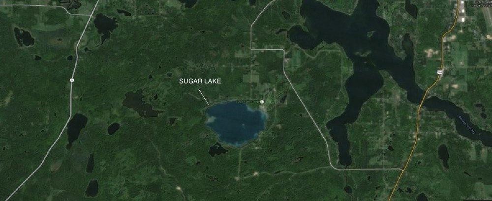 Even from a satellite Sugar Lake stands out from neighboring lakes as the Caribbean-colored jewel of the North.