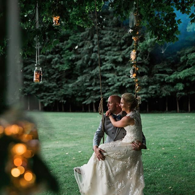 Jenna and Joe swinging from the old maple tree at Sugarcrest.  #sugarcrest, #lakewedding, #jennaandjoewedding, #treeswing, #vacationrental,
