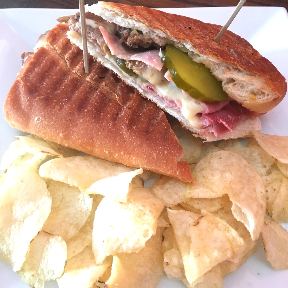 Cuban sandwich - Mojo marinated pork, sliced ham, gruyere cheese, pickles