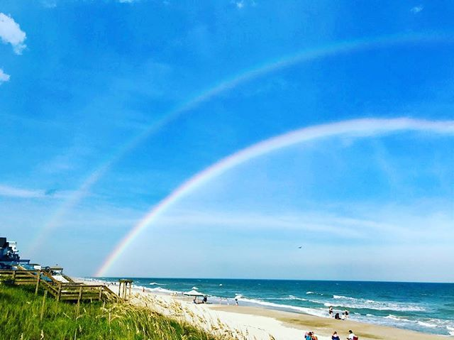 Shop intern @meyend_candy sprinted over to the beach searching for gold. He came back with this sweet picture. #surfcity #rainbow #potofgold #onthebeach #nc #northcarolina #beach #ocean