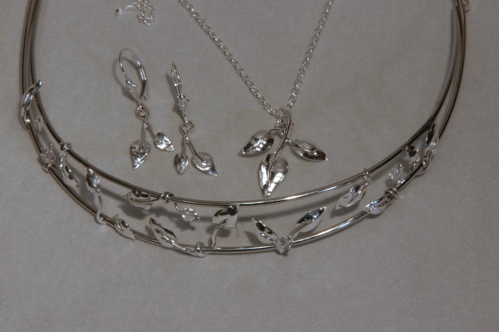Sterling silver leaf motif bridal set of a tiara, earrings, & pendant.