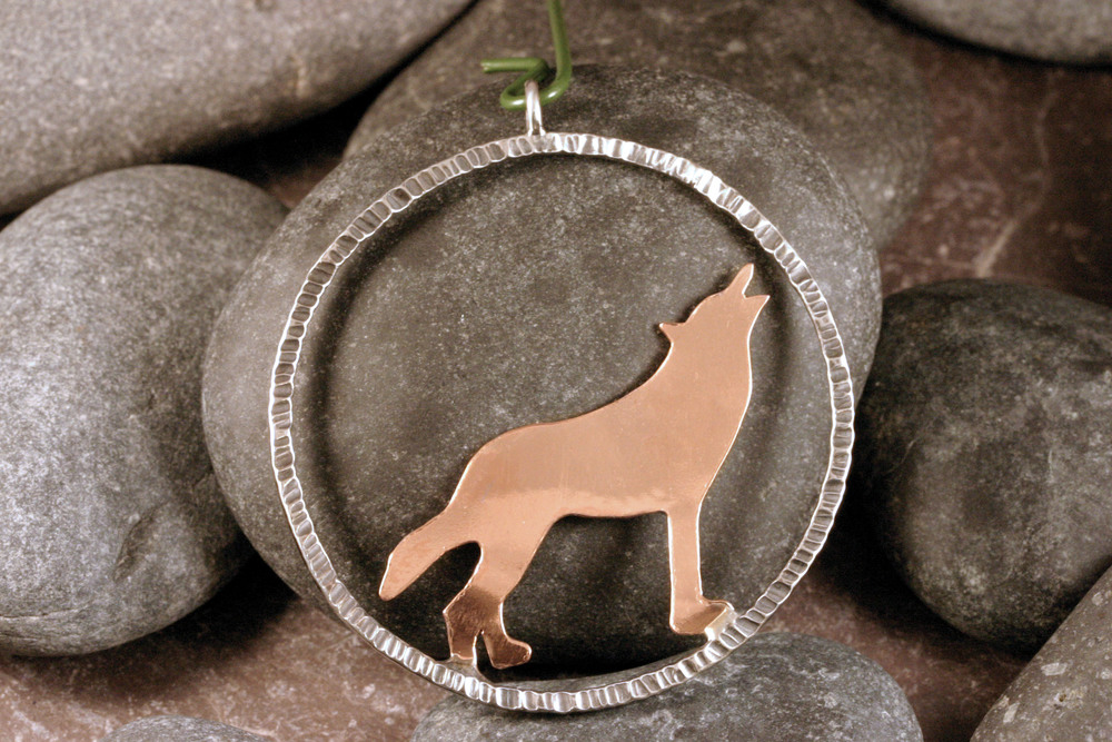 Sterling silver & copper wolf silhouette ornament.