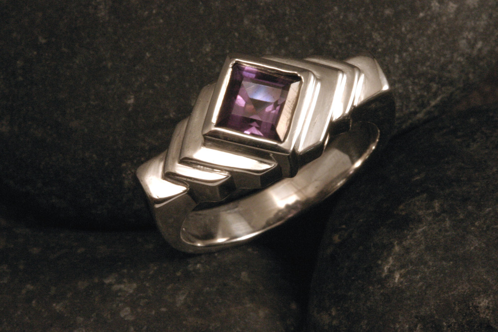 A geometric sterling silver amethyst ring.