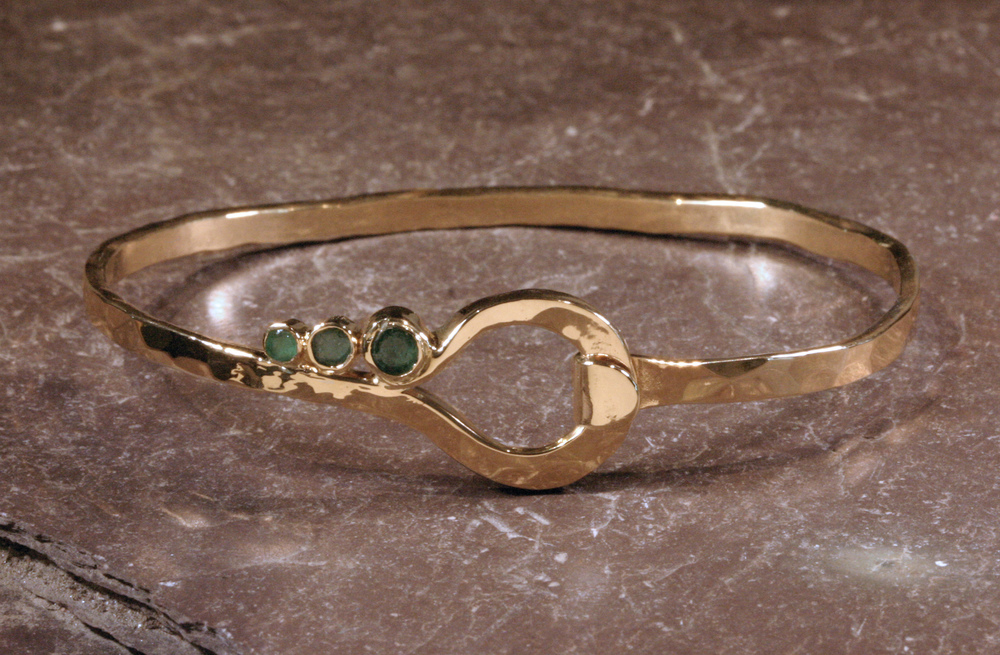 14K gold shepherd hook bracelet set with customer's emeralds.