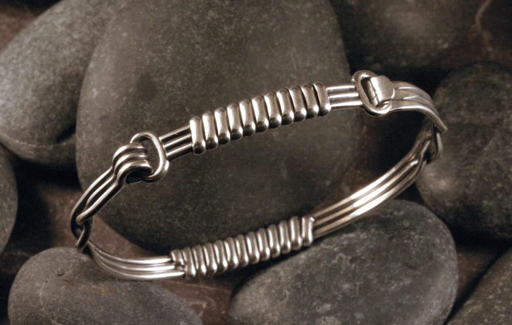 Sterling silver hinged elephant hair bangle bracelet.