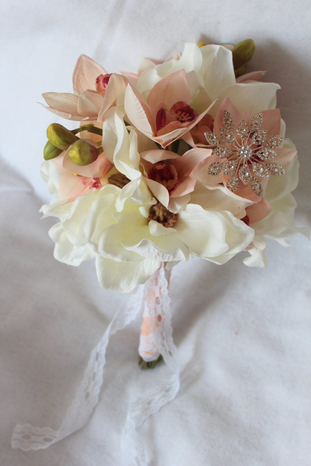 minneapolis-silk-florist-Magnolia-and-Fresh-Touch-Cymbidium-Orchid-Silk-Bouquet-in-Mauve-Coral-&-Cream-with-Jewel-Muslin-and-Lace-Accent-with-Matching-Boutonniere.jpg