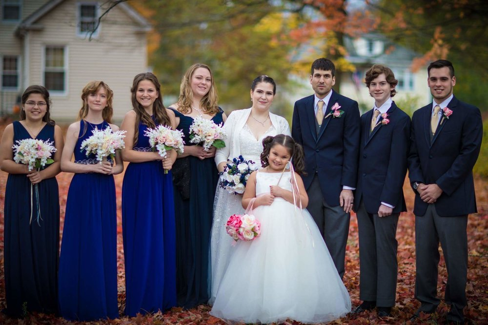 The lovely wedding party in their various shades of navy.