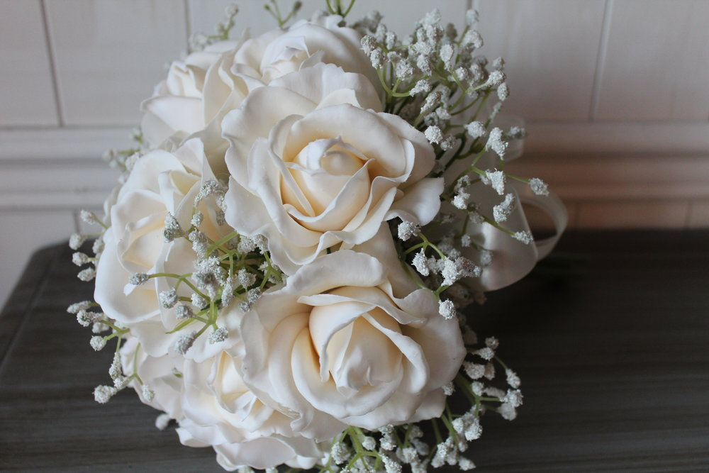 You can read the story behind this simple white bouquet  here .
