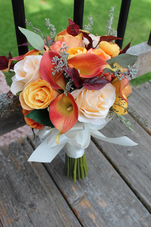 Calla Lilies, Roses, Ranunculus, Eucalyptus