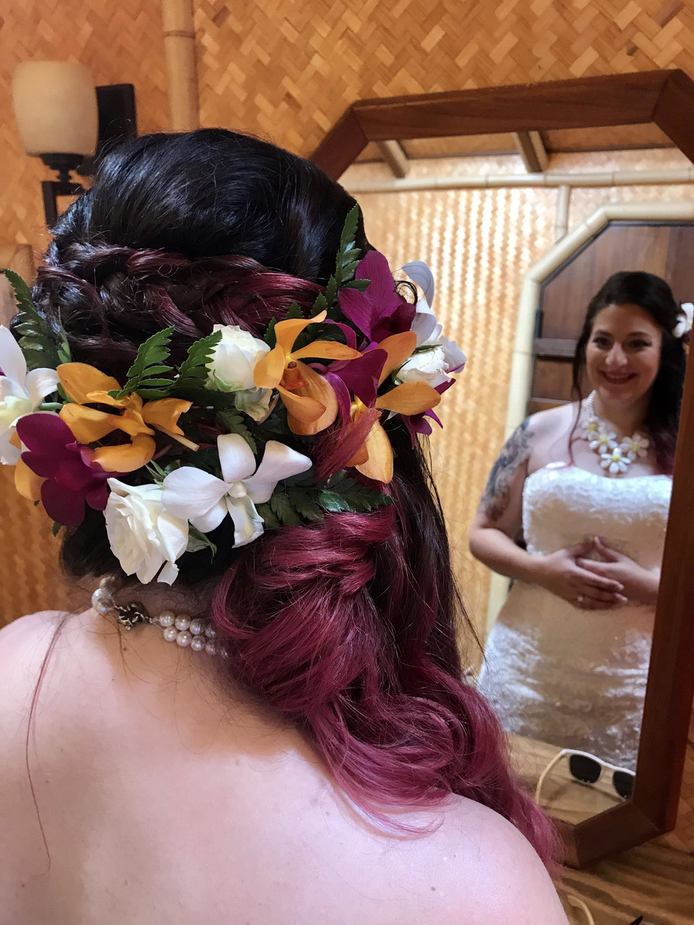 Caitlyn had orange orchids in her hair that she requested be added to her bouquet recreation. It was a fun little way to include yet another detail from their destination wedding.