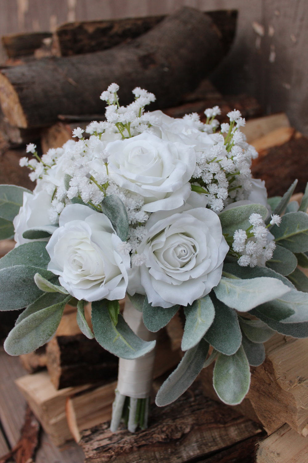 White Roses and Baby's Breath, softened up with Lamb's Ear and Ivory Ribbon