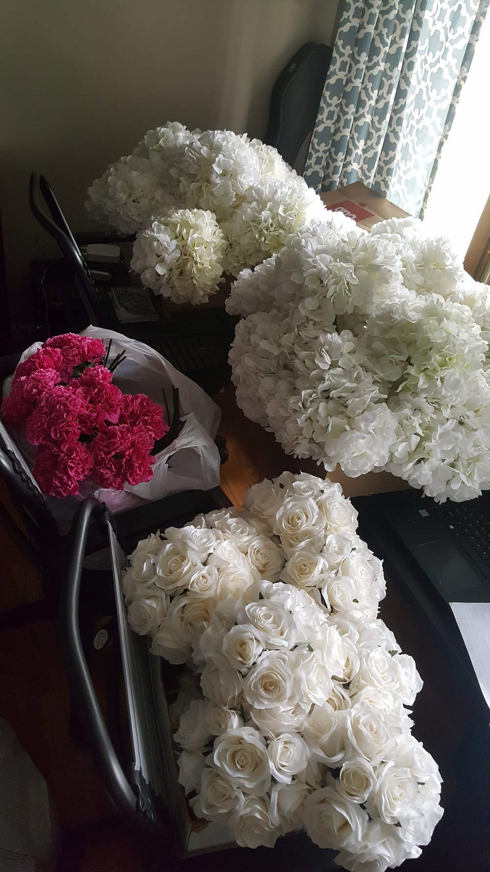 White and pink clusters going in Mercury Mason Jars and bud vases on the guest tables.