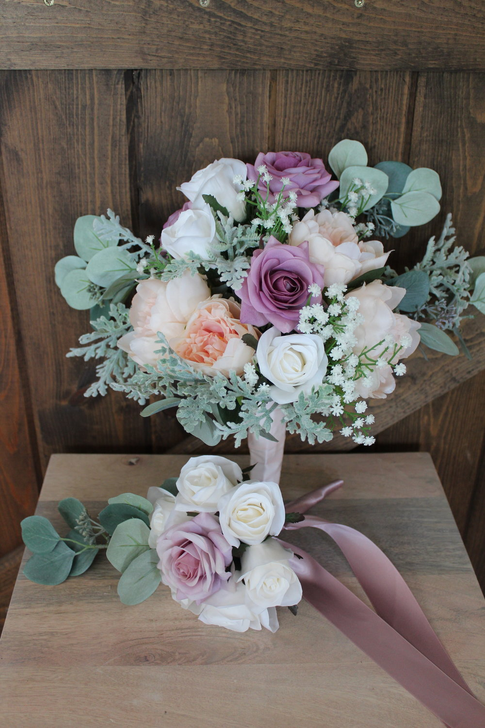 One of the bridesmaid bouquets with the cute little toss bouquet. The toss included ivory Roses, a single dark mauve Rose, Seeded Eucalyptus and that beautiful mauve satin ribbon.