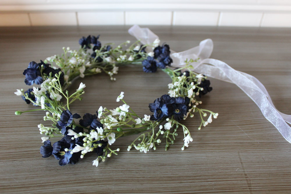 Flower girl headpiece: baby's breath and blue accent flowers.
