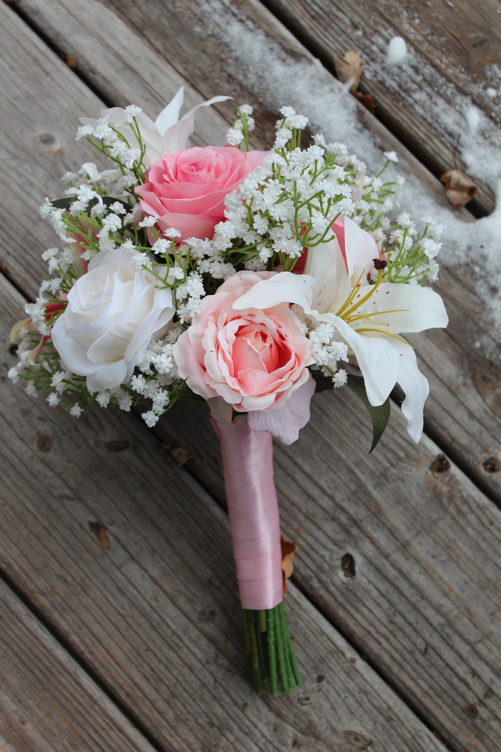 Lilies, roses and baby's breath. Simple, beautiful, elegant!