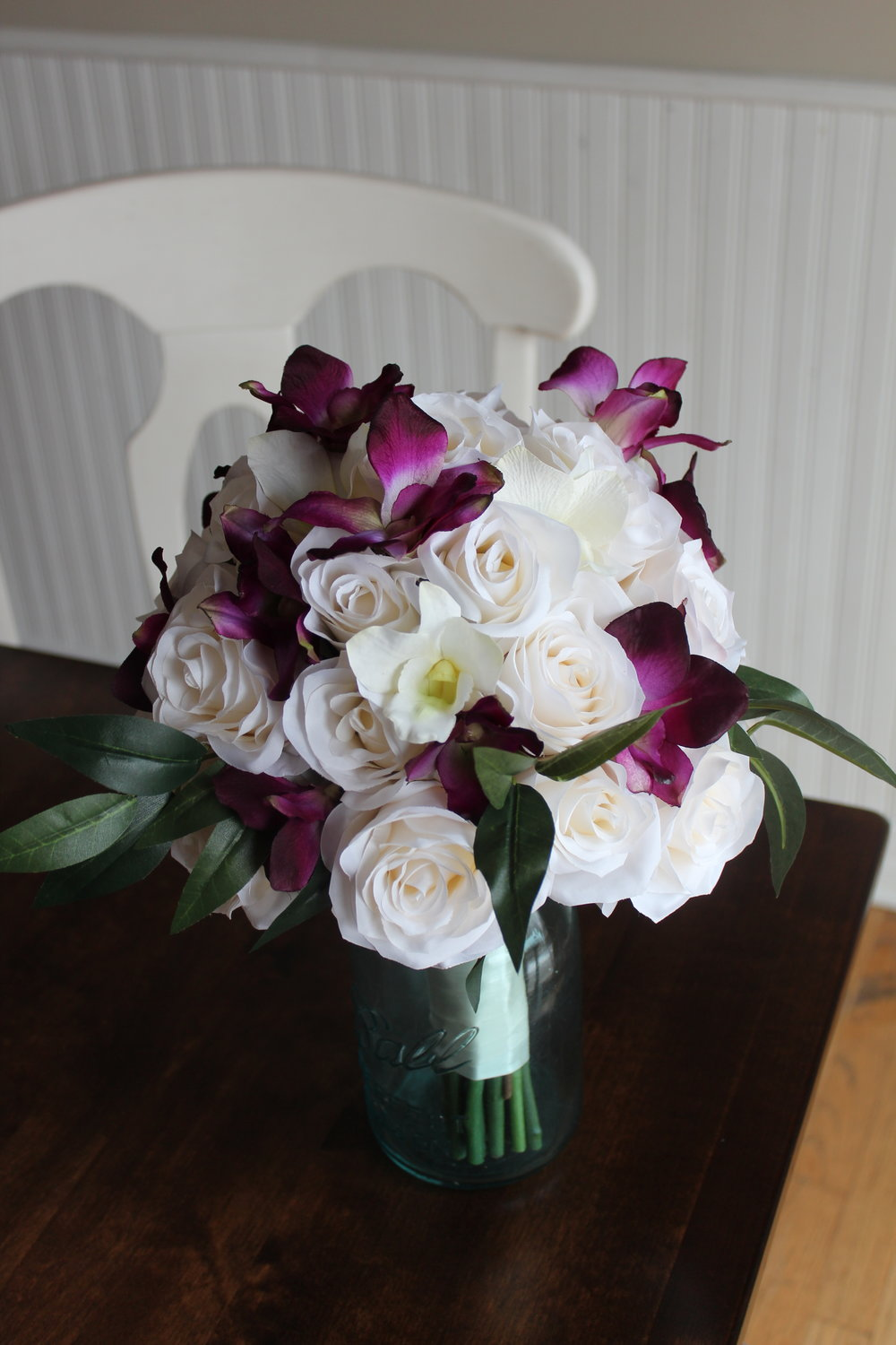 Ivory Roses, Ivory and Purple Dendrobium Orchids, Ruscus.