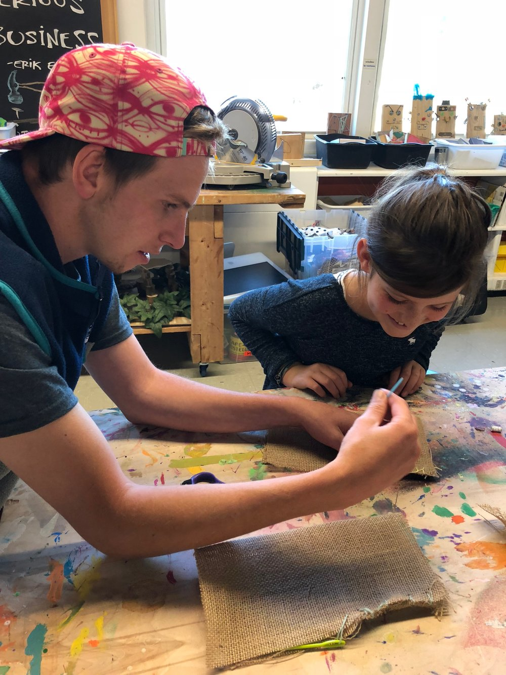 Zach - Zach works with our afterschool classes. He brings a fun playful energy matched only by his awesome experience in screen printing, painting, and other forms of graphic art.