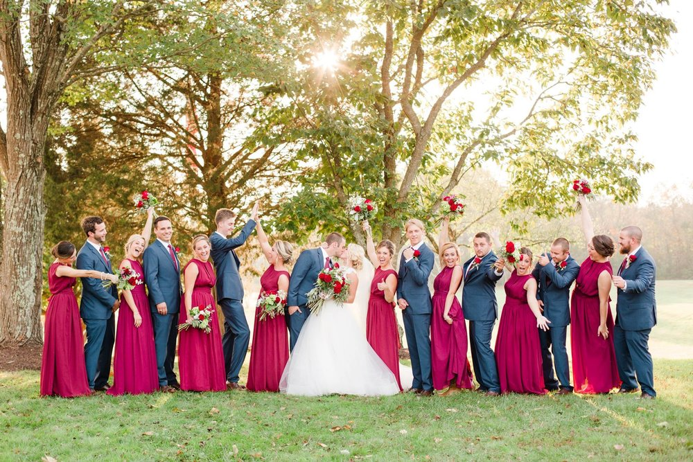 Bridal Party with Bride and Groom Kissing